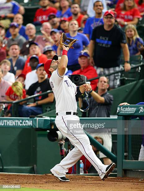 Mitch Moreland of the Texas Rangers catches a pop fly in the third inning against the Oakland Athletics at Globe Life Park in Arlington on August 16...