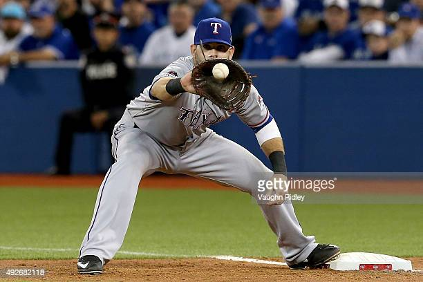 Mitch Moreland of the Texas Rangers catches the ball at first base on a bunt attempt by Ben Revere of the Toronto Blue Jays in the fifth inning in...
