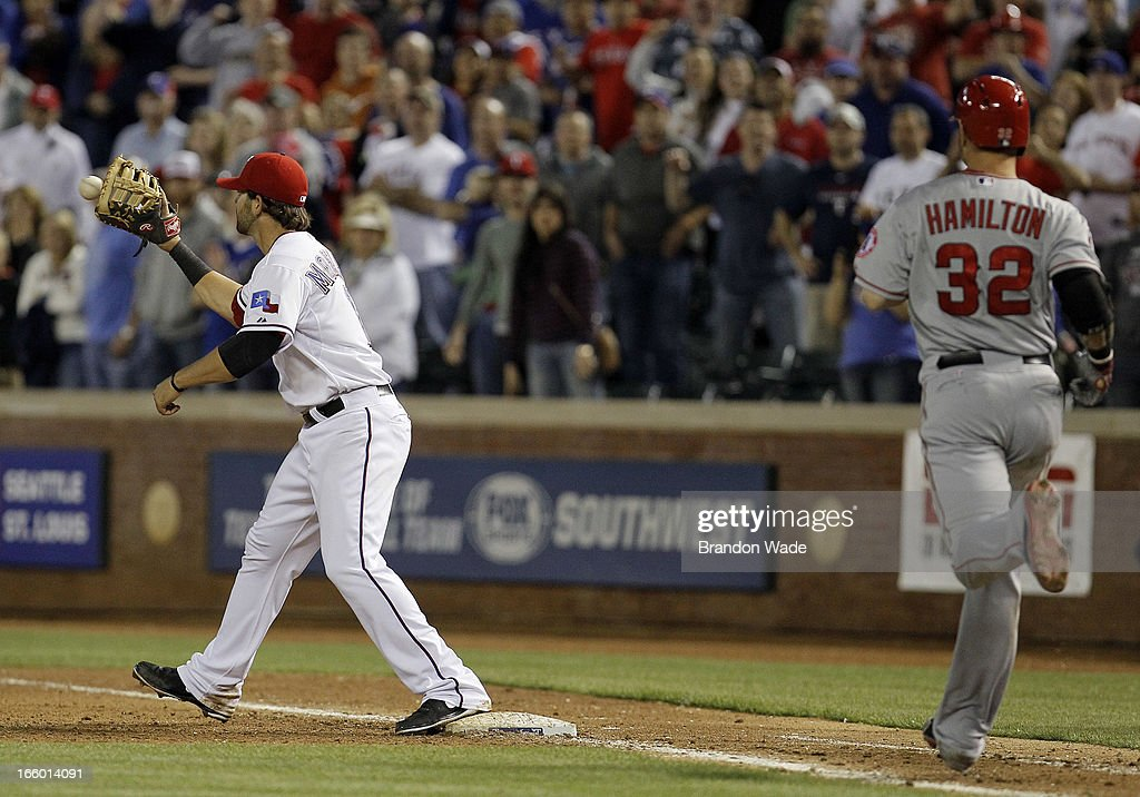 <a gi-track='captionPersonalityLinkClicked' href=/galleries/search?phrase=Mitch+Moreland&family=editorial&specificpeople=6824046 ng-click='$event.stopPropagation()'>Mitch Moreland</a> #18 of the Texas Rangers catches the ball to force out Josh Hamilton #32 of the Los Angeles Angels of Anaheim in the ninth inning of a baseball game at Rangers Ballpark in Arlington on April 7, 2013 in Arlington, Texas.