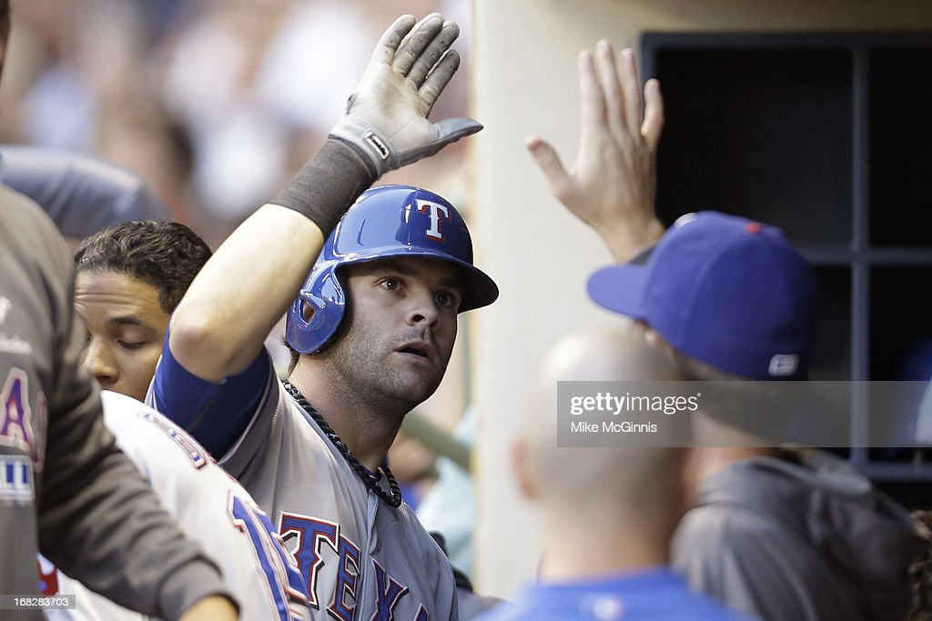 <a gi-track='captionPersonalityLinkClicked' href=/galleries/search?phrase=Mitch+Moreland&family=editorial&specificpeople=6824046 ng-click='$event.stopPropagation()'>Mitch Moreland</a> #18 of the Texas Rangers celebrates in the dugout after hitting a solo home run in the top of the second inning against the Milwaukee Brewers at Miller Park on May 07, 2013 in Milwaukee, Wisconsin.