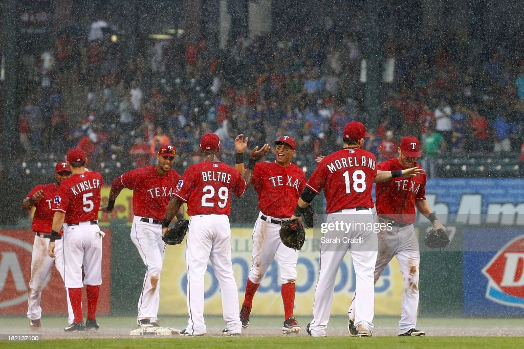 <a gi-track='captionPersonalityLinkClicked' href=/galleries/search?phrase=Mitch+Moreland&family=editorial&specificpeople=6824046 ng-click='$event.stopPropagation()'>Mitch Moreland</a> #18 of the Texas Rangers celebrates with <a gi-track='captionPersonalityLinkClicked' href=/galleries/search?phrase=Adrian+Beltre&family=editorial&specificpeople=202631 ng-click='$event.stopPropagation()'>Adrian Beltre</a> #29 and <a gi-track='captionPersonalityLinkClicked' href=/galleries/search?phrase=Ian+Kinsler&family=editorial&specificpeople=538104 ng-click='$event.stopPropagation()'>Ian Kinsler</a> #5 after a game against the Los Angeles Angels of Anaheim at Rangers Ballpark in Arlington on September 28, 2013 in Arlington, Texas. The Texas Rangers defeated the Los Angeles Angels of Anaheim 7-4.