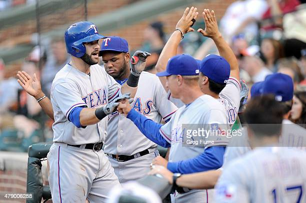 Mitch Moreland of the Texas Rangers celebrates with teammates after hitting a home run in the second inning against the Baltimore Orioles at Oriole...