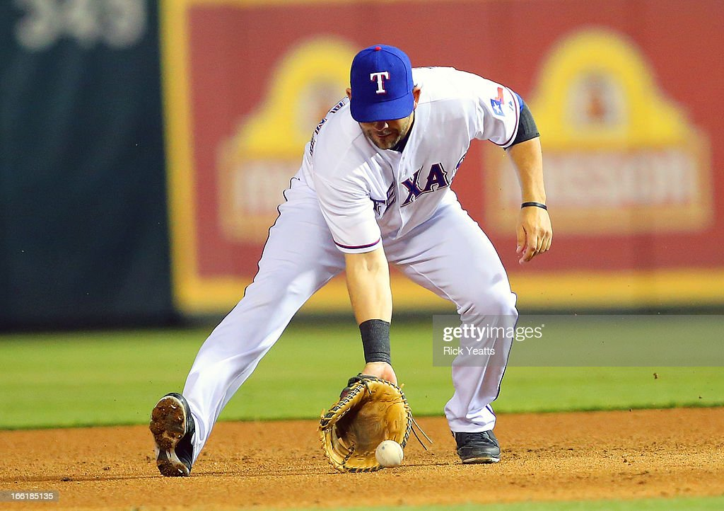 <a gi-track='captionPersonalityLinkClicked' href=/galleries/search?phrase=Mitch+Moreland&family=editorial&specificpeople=6824046 ng-click='$event.stopPropagation()'>Mitch Moreland</a> #18 of the Texas Rangers fields a ground ball hit by Ben Zobrist #18 of the Tampa Bay Rays at Rangers Ballpark in Arlington on April 9, 2013 in Arlington, Texas.