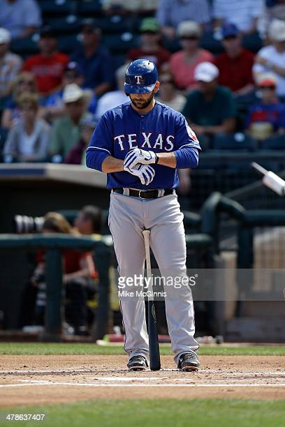Mitch Moreland of the Texas Rangers gets ready for the next pitch during the spring training game against the Kansas City Royals at Surprise Stadium...