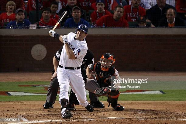 Mitch Moreland of the Texas Rangers hits a 3run home run in the bottom of the second inning against the San Francisco Giants in Game Three of the...