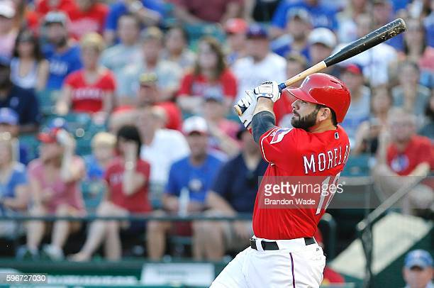 Mitch Moreland of the Texas Rangers hits a grand slam during the first inning of a baseball game against the Cleveland Indians at Globe Life Park on...