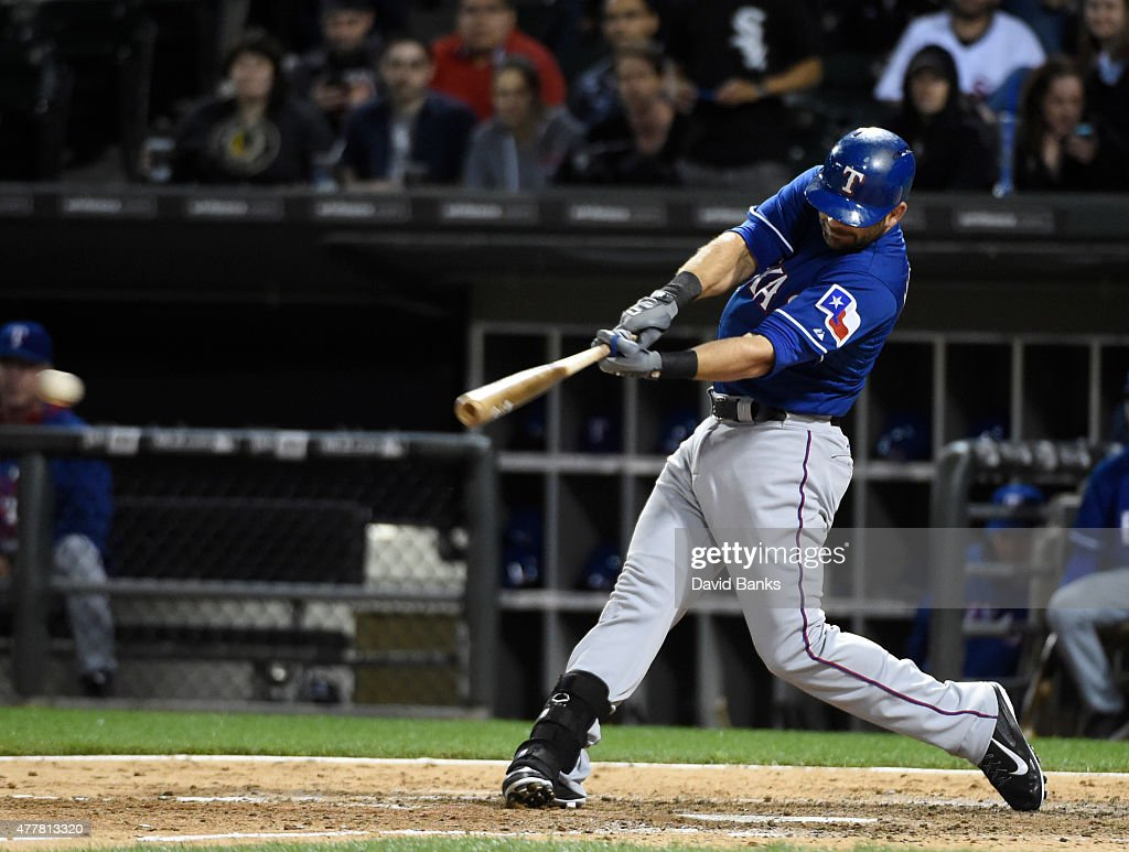 Mitch Moreland #18 of the Texas Rangers hits a two-RBI game winning single against the Chicago White Sox during the ninth inning on June 19, 2015 at U. S. Cellular Field in Chicago, Illinois. The Rangers defeated the White Sox 2-1.