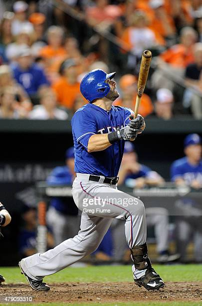 Mitch Moreland of the Texas Rangers hits a tworun home run in the eighth inning against the Baltimore Orioles at Oriole Park at Camden Yards on June...