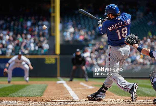 Mitch Moreland of the Texas Rangers hits a tworun single in the second inning against the Seattle Mariners at Safeco Field on April 27 2014 in...
