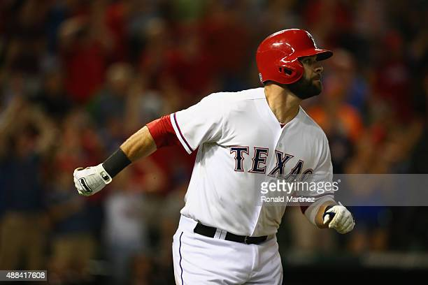 Mitch Moreland of the Texas Rangers hits a walkoff single against the Houston Astros in the ninth inning at Globe Life Park in Arlington on September...