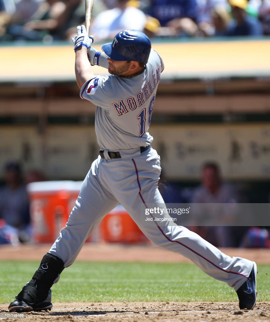 <a gi-track='captionPersonalityLinkClicked' href=/galleries/search?phrase=Mitch+Moreland&family=editorial&specificpeople=6824046 ng-click='$event.stopPropagation()'>Mitch Moreland</a> #18 of the Texas Rangers hits an RBI sacrafice against the Oakland Athletics at O.co Coliseum on August 14, 2011 in Oakland, California.