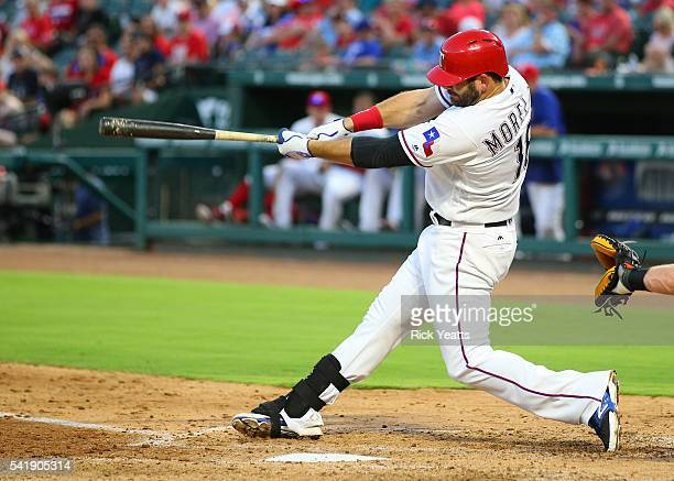 Mitch Moreland of the Texas Rangers hits in the fourth inning loading the bases against the Baltimore Orioles at Globe Life Park in Arlington on June...