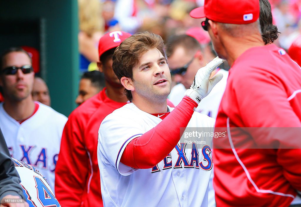 <a gi-track='captionPersonalityLinkClicked' href=/galleries/search?phrase=Mitch+Moreland&family=editorial&specificpeople=6824046 ng-click='$event.stopPropagation()'>Mitch Moreland</a> #18 of the Texas Rangers is congratulated by his teammates for hitting a solo home run in the fourth inning against the Seattle Mariners at Rangers Ballpark in Arlington on April 21, 2013 in Arlington, Texas.