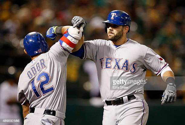 Mitch Moreland of the Texas Rangers is congratulated by Rougned Odor after he hit a tworun home run against the Oakland Athletics in the sixth inning...