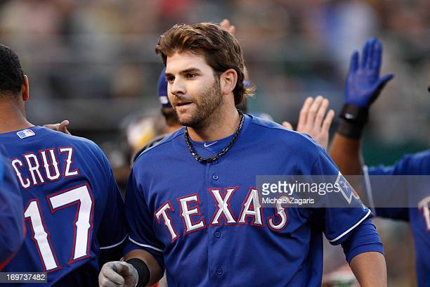 Mitch Moreland of the Texas Rangers is greeted after hitting a home run during the game against the Oakland Athletics at Oco Coliseum on May 14 2013...