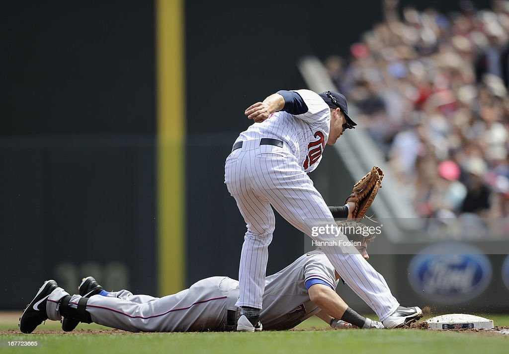 Mitch Moreland #18 of the Texas Rangers is out at first base after a tag was applied by Justin Morneau #33 of the Minnesota Twins during the third inning of the game on April 28, 2013 at Target Field in Minneapolis, Minnesota.
