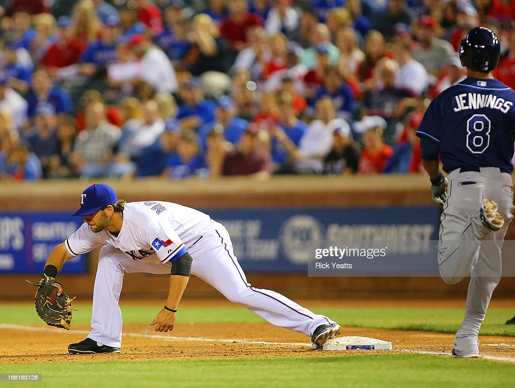 <a gi-track='captionPersonalityLinkClicked' href=/galleries/search?phrase=Mitch+Moreland&family=editorial&specificpeople=6824046 ng-click='$event.stopPropagation()'>Mitch Moreland</a> #18 of the Texas Rangers makes the catch for the out on <a gi-track='captionPersonalityLinkClicked' href=/galleries/search?phrase=Desmond+Jennings&family=editorial&specificpeople=5974085 ng-click='$event.stopPropagation()'>Desmond Jennings</a> #8 of the Tampa Bay Rays at Rangers Ballpark in Arlington on April 9, 2013 in Arlington, Texas.