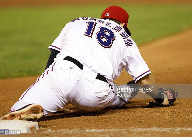 Mitch Moreland of the Texas Rangers makes the play at first base to end the eighth inning during Game Five of the MLB World Series against the St...