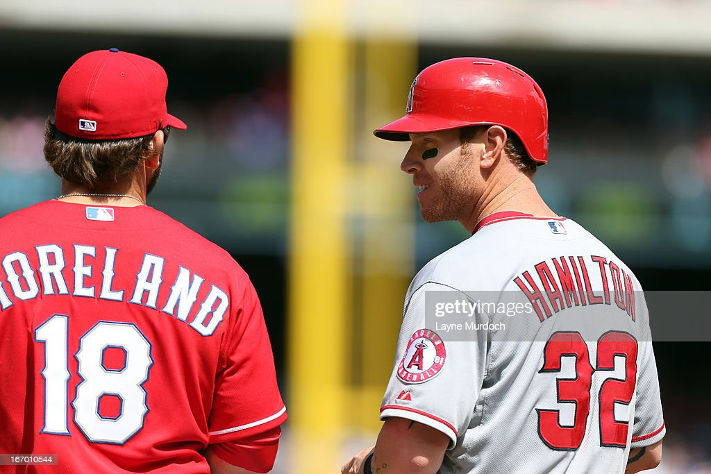 <a gi-track='captionPersonalityLinkClicked' href=/galleries/search?phrase=Mitch+Moreland&family=editorial&specificpeople=6824046 ng-click='$event.stopPropagation()'>Mitch Moreland</a> #18 of the Texas Rangers talks with Josh Hamilton #32 of the Los Angeles Angels of Anaheim on April 6, 2013 at the Rangers Ballpark in Arlington, Texas.