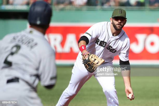 Mitch Moreland tosses the ball to first base for the out in the first inning of a game against the Seattle Mariners at Fenway Park on May 27 2017 in...