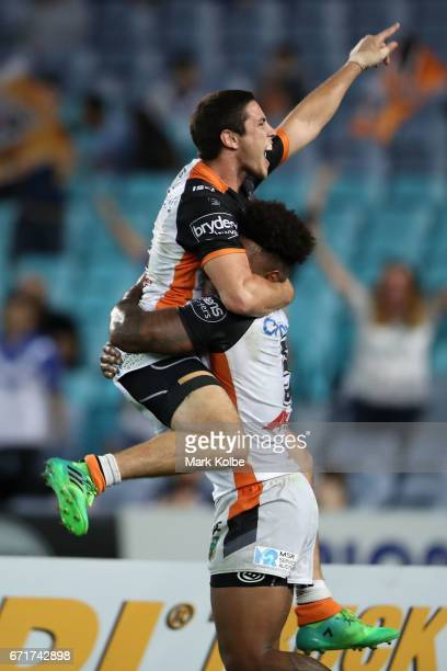 Mitch Moses and Kevin Naiqama of the Tigers celebrate Kevin Naiqama scoring a try during the round eight NRL match between the Wests Tigers and the...