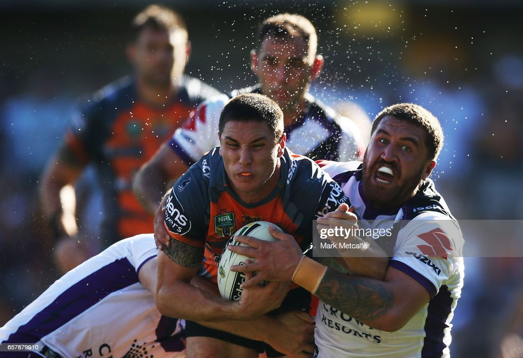 Mitch Moses of the Tigers is tackled during the round four NRL match between the Wests Tigers and the Melbourne Storm at Leichhardt Oval on March 26, 2017 in Sydney, Australia.