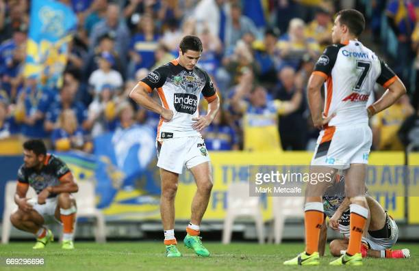 Mitch Moses of the Tigers looks dejected after defeat in the round seven NRL match between the Parramatta Eels and the Wests Tigers at ANZ Stadium on...