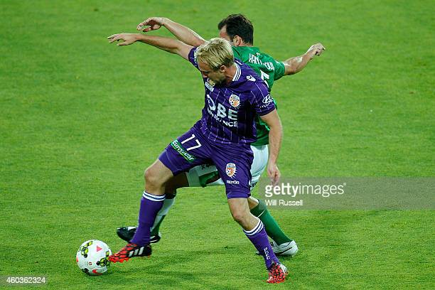 Mitch Nichols of the Glory and Ben Kantarovski of the Jets challenge for the ball during the round 11 ALeague match between Perth Glory and Newcastle...