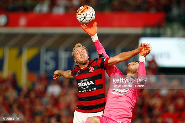 Mitch Nichols of the Wanderers battles for the ball with Sydney FC's Vedran Janjetovic during the round 15 ALeague match between the Western Sydney...