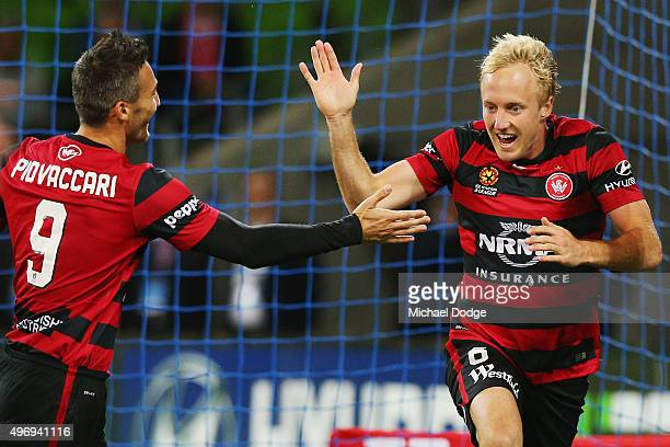 Mitch Nichols of the Wanderers celebrates a goal with Frederico Piovaccari during the round six ALeague match between Melbourne City FC and the...
