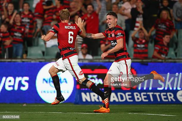 Mitch Nichols of the Wanderers celebrates with his team mate Scott Neville of the Wanderers after scoring a goal during the round nine ALeague match...