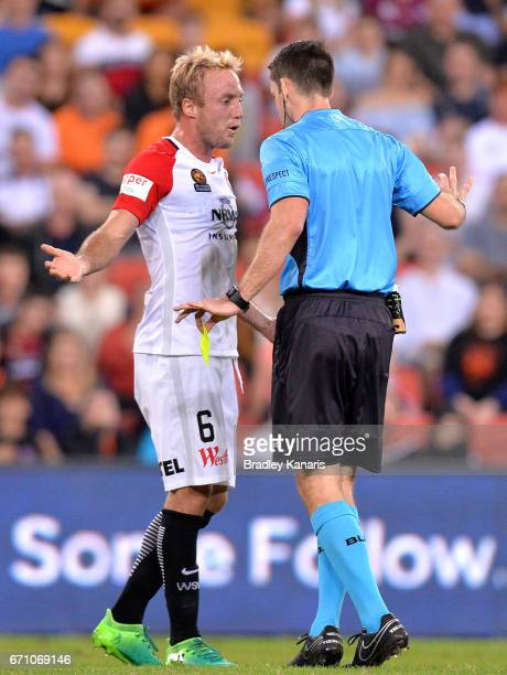 Mitch Nichols of the Wanderers debates a call with referee Jarred Gillett during the ALeague Elimination Final match between the Brisbane Roar and...