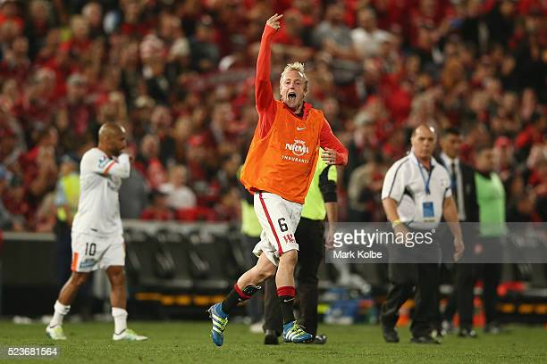 Mitch Nichols of the Wanderers gestures to the Roar supporters as he celebrates victory during the ALeague Semi Final match between the Western...
