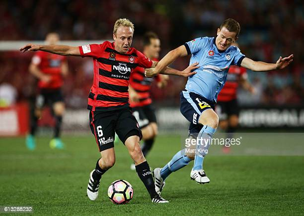 Mitch Nichols of the Wanderers is challenged by Brandon O'Neill of Sydney FC during the round one ALeague match between the Western Sydney Wanderers...