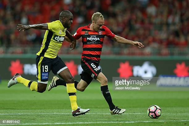 Mitch Nichols of the Wanderers is challenged by Jacques Faty of the Mariners during the round four ALeague match between the Western Sydney Wanderers...