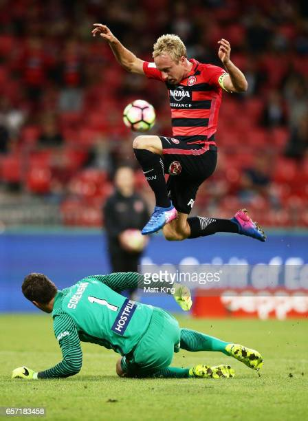 Mitch Nichols of the Wanderers misses an opportunity on goal as he jumps over Melbourne City goalkeeper Thomas Sorensen during the round 24 ALeague...