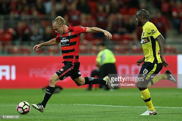 Mitch Nichols of the Wanderers takes a shot at goal during the round four ALeague match between the Western Sydney Wanderers and the Central Coast...