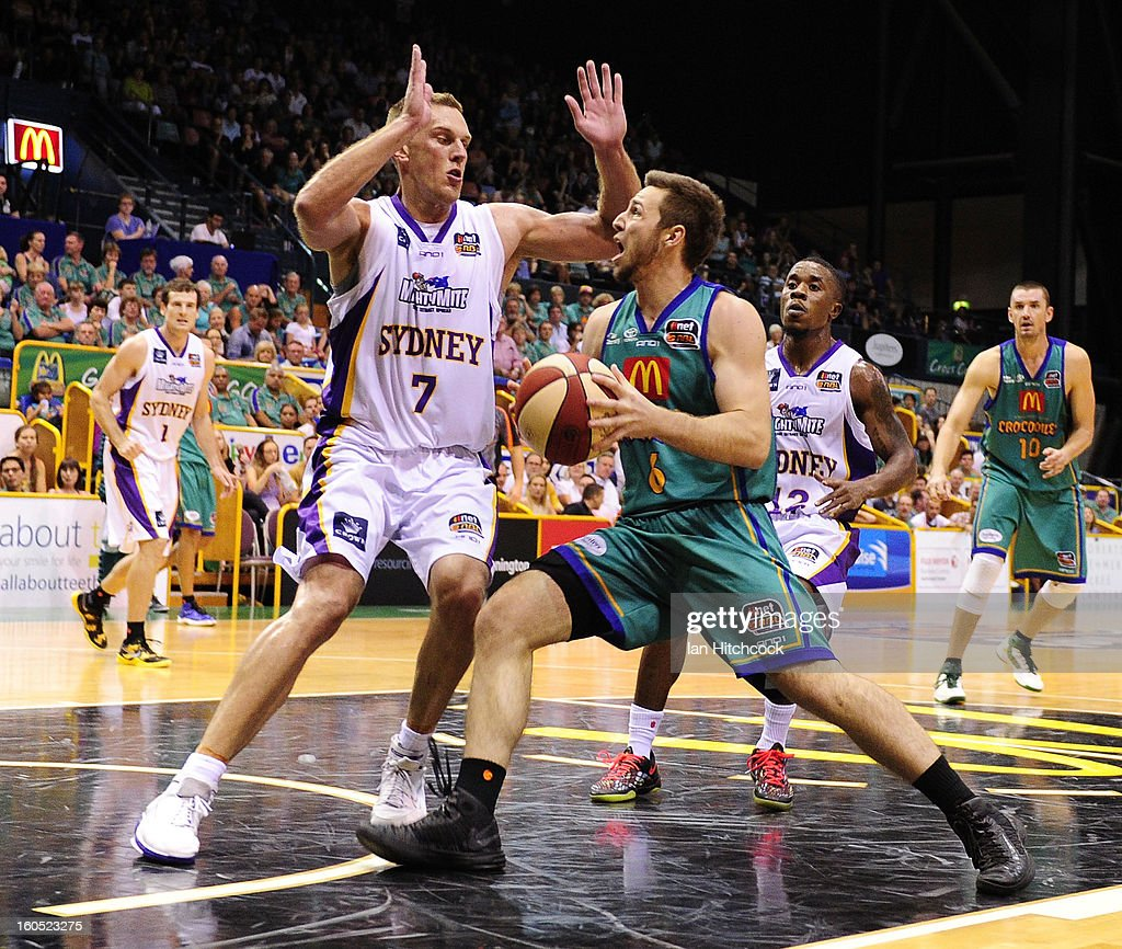 Mitch Norton of the Crocodiles attempts to drive past Graeme Dann of the Kings during the round 17 NBL match between the Townsville Crodcodiles and the Sydney Kings at Townsville Entertainment Centre on February 2, 2013 in Townsville, Australia.