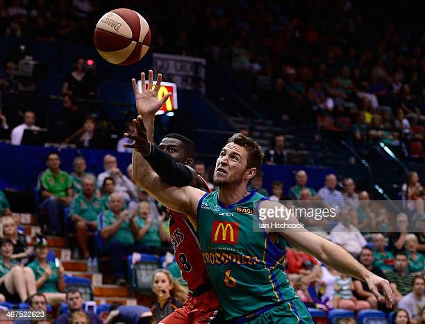 Mitch Norton of the Crocodiles contests the ball with James Ennis of the Wildcats during the round 17 NBL match between the Townsville Crocodiles and...