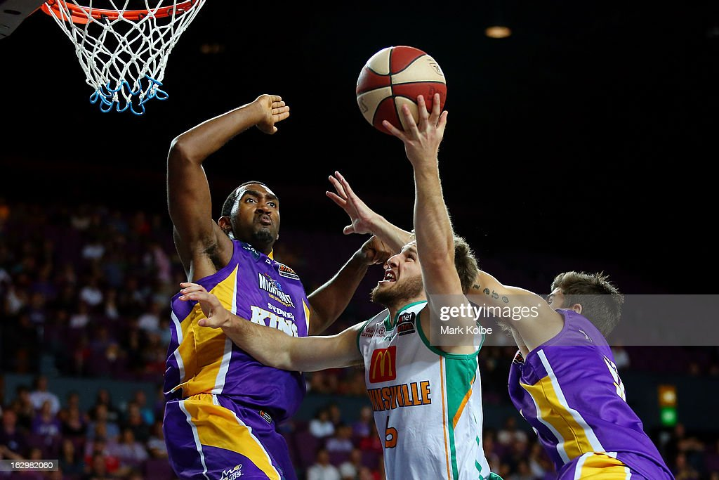 Mitch Norton of the Crocs shoots under pressure from Darnell Lazare of the Kings during the round 21 NBL match between the Sydney Kings and the Townsville Crocodiles at Sydney Entertainment Centre on March 3, 2013 in Sydney, Australia.