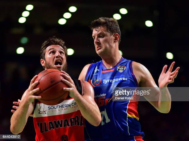 Mitch Norton of the Illawarra Hawks drives to the basket as Daniel Johnson of the Adelaide 36ers defends during game three of the NBL Semi Final...