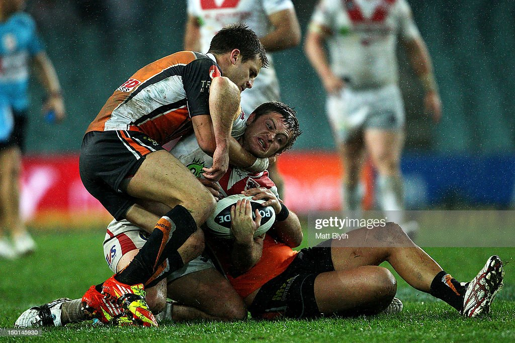Mitch Rein of the Dragons is tackled during the round 23 NRL match between the Wests Tigers and the St George Illawarra Dragons at Allianz Stadium on August 11, 2012 in Sydney, Australia.