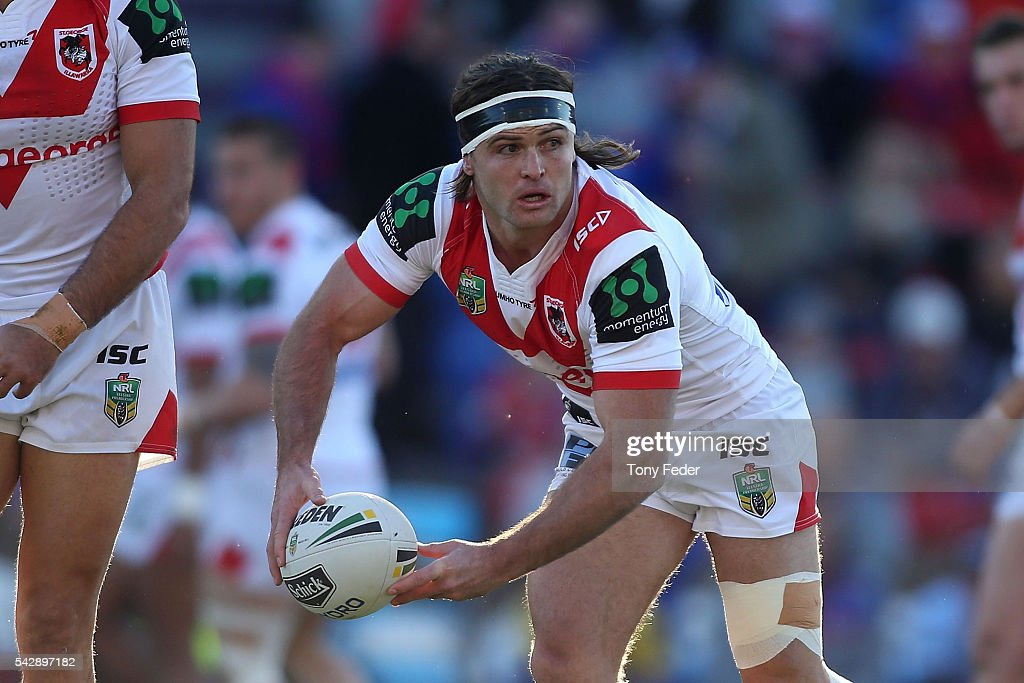 Mitch Rein of the Dragons looks to pass the ball during the round 16 NRL match between the Newcastle Knights and the St George Illawarra Dragons at Hunter Stadium on June 25, 2016 in Newcastle, Australia.