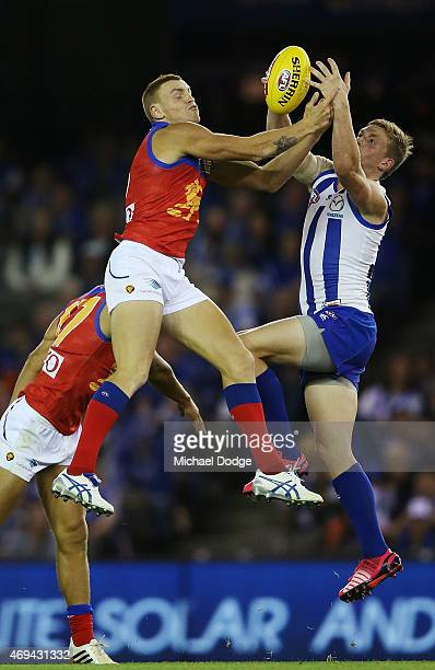 Mitch Robinson of the Lions competes for the ball against Jack Ziebell of the Kangaroos during the round two AFL match between the North Melbourne...