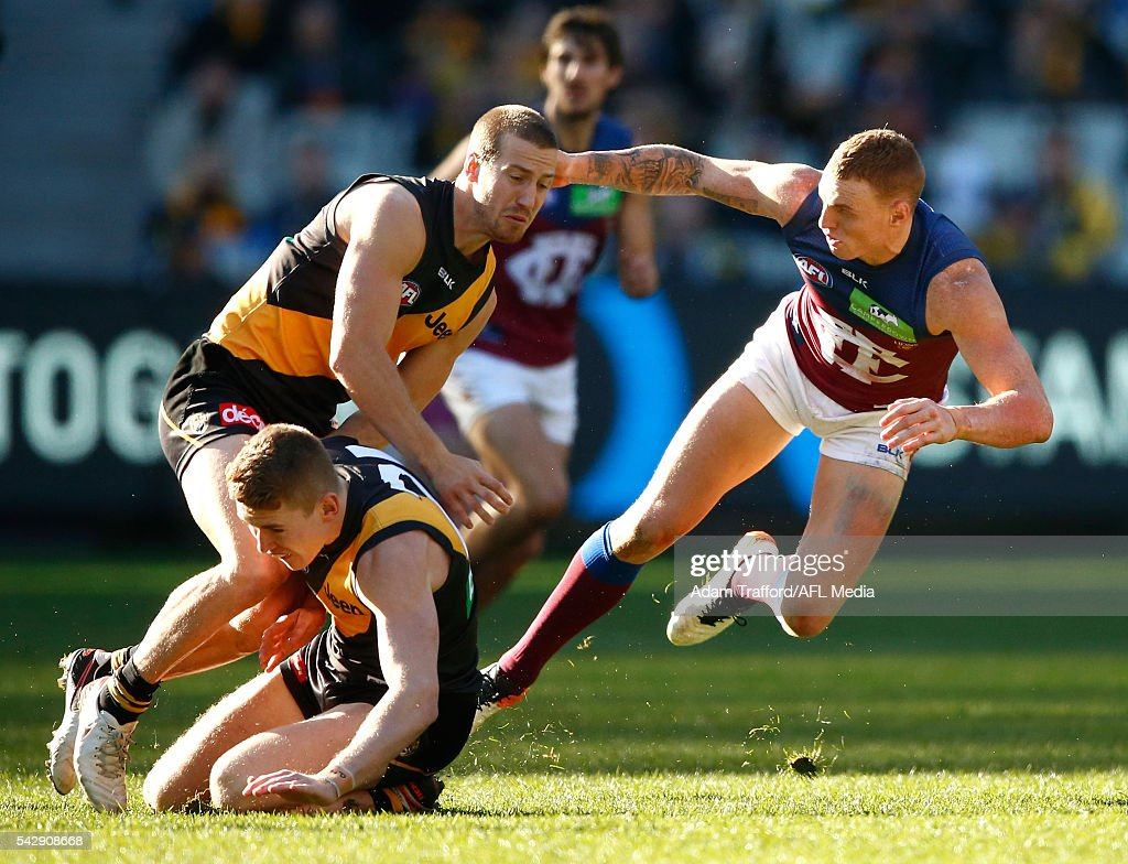 Mitch Robinson of the Lions is seen injured after a heavy knock during the 2016 AFL Round 14 match between the Richmond Tigers and the Brisbane Lions at the Melbourne Cricket Ground on June 25, 2016 in Melbourne, Australia.