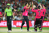 Mitch Starc of the Sixers celebrates with team mates after claiming the wicket of Jacques Kallis of the Thunder during the Big Bash League match...