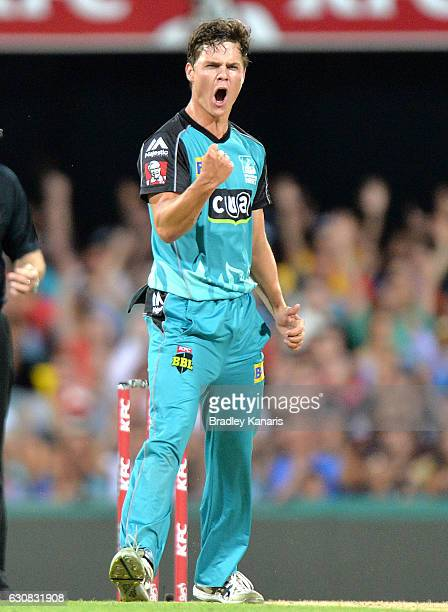 Mitch Swepson of the Heat celebrates taking the wicket of Sam Billings of the Sixers during the Big Bash League match between the Brisbane Heat and...