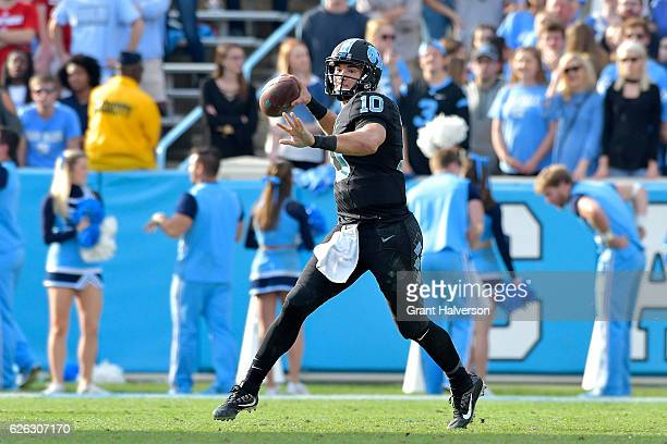Mitch Trubisky of the North Carolina Tar Heels against the North Carolina State Wolfpack during their game at Kenan Stadium on November 25 2016 in...