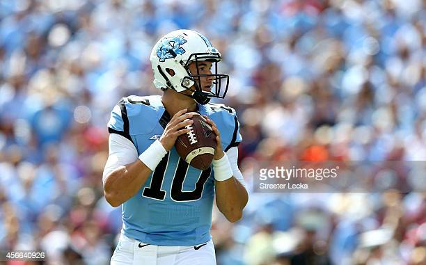 Mitch Trubisky of the North Carolina Tar Heels drops back to pass against the Virginia Tech Hokies during their game at Kenan Stadium on October 4...