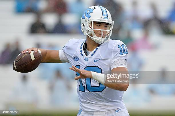 Mitch Trubisky of the North Carolina Tar Heels drops back to pass against the Delaware Fightin Blue Hens during their game at Kenan Stadium on...